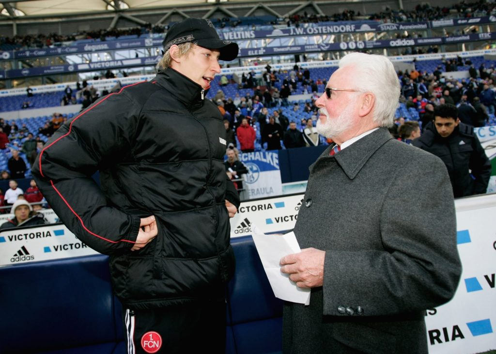 GELSENKIRCHEN, GERMANY - FEBRUARY 25: President Michael A. Roth of Nuremberg speaks to Stefan Kiessling before the Bundesliga match between FC Schalke 04 and 1. FC Nuremberg at the Veltins Arena on February 25, 2006 in Gelsenkirchen, Germany. (Photo by Christof Koepsel/Bongarts/Getty Images)