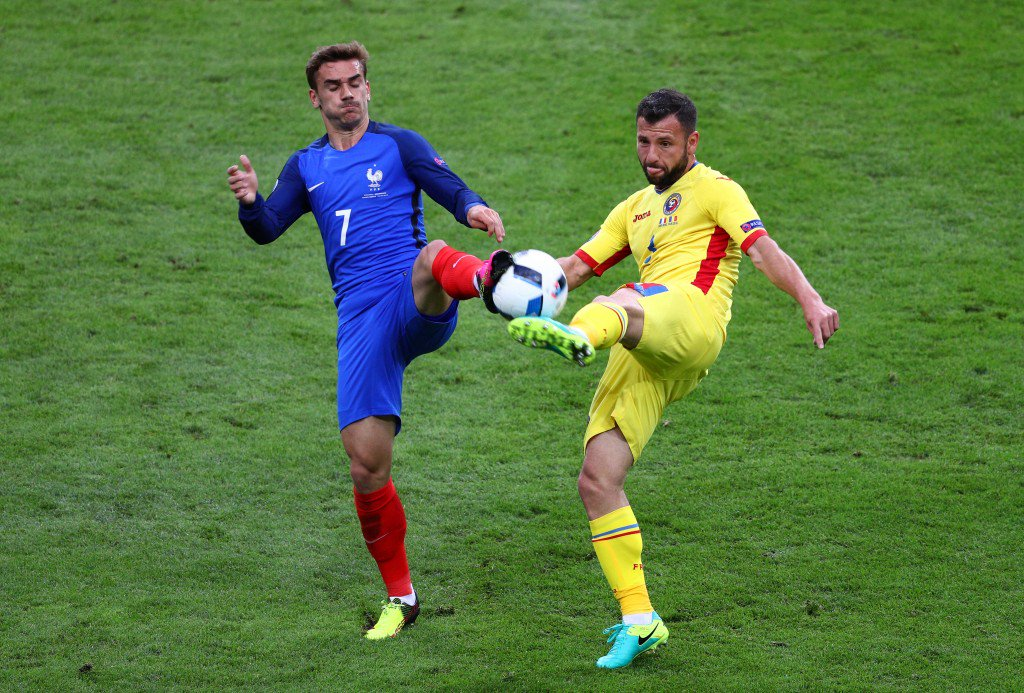 PARIS, FRANCE - JUNE 10: Ovidiu Hoban of Romania and Antoine Griezmann of France compete for the ball during the UEFA Euro 2016 Group A match between France and Romania at Stade de France on June 10, 2016 in Paris, France. (Photo by Paul Gilham/Getty Images)