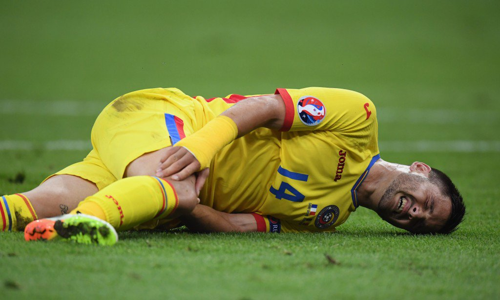 PARIS, FRANCE - JUNE 10: Florin Andone of Romania lies injured during the UEFA Euro 2016 Group A match between France and Romania at Stade de France on June 10, 2016 in Paris, France. (Photo by Matthias Hangst/Getty Images)