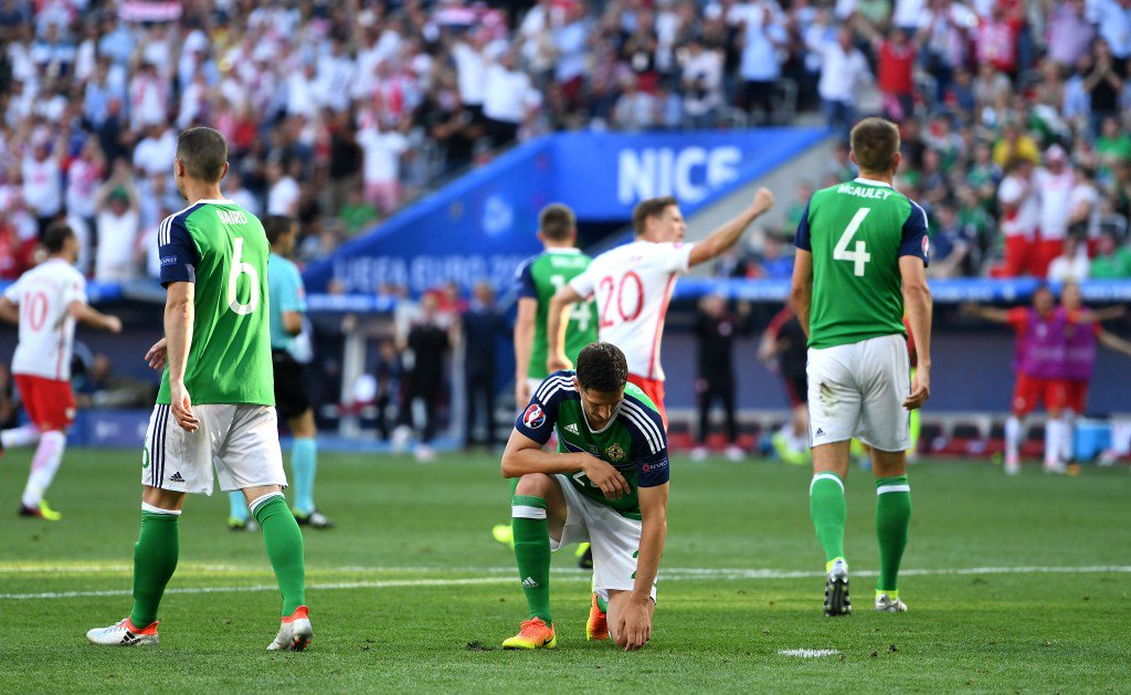 NICE, FRANCE - JUNE 12: Craig Cathcart (C) of Northern Ireland shows his dejection after Poland