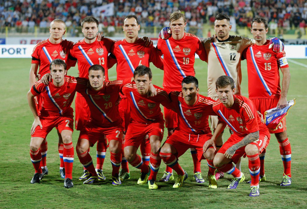 DUBAI, UNITED ARAB EMIRATES - NOVEMBER 19: Russia national team pose for a team photo prior to the International Football match between South Korea and Russia at the Zabeel Staduim on November 19, 2013 in Dubai, United Arab Emirates. (Photo by Francois Nel/Getty Images)