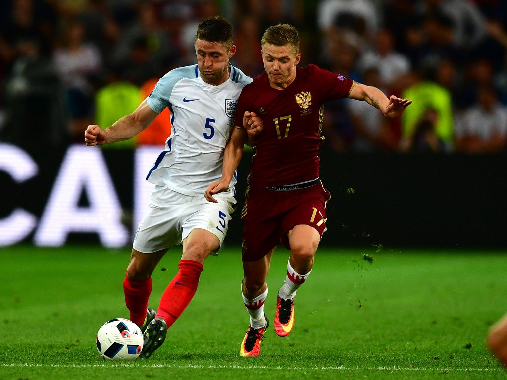 MARSEILLE, FRANCE - JUNE 11: Gary Cahill of England and Oleg Shatov of Russia compete for the ball during the UEFA EURO 2016 Group B match between England and Russia at Stade Velodrome on June 11, 2016 in Marseille, France. (Photo by Dan Mullan/Getty Images)