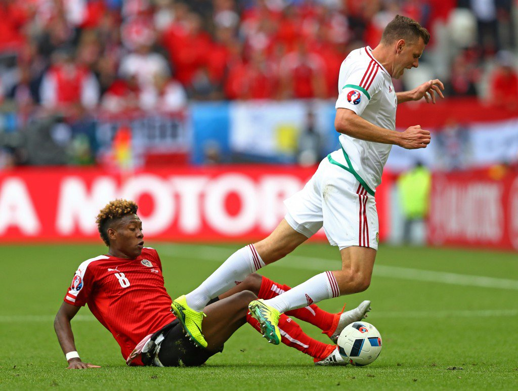 BORDEAUX, FRANCE - JUNE 14: Adam Szalai of Hungary is tackled by David Alaba of Austria during the UEFA EURO 2016 Group F match between Austria and Hungary at Stade Matmut Atlantique on June 14, 2016 in Bordeaux, France. (Photo by Dean Mouhtaropoulos/Getty Images)