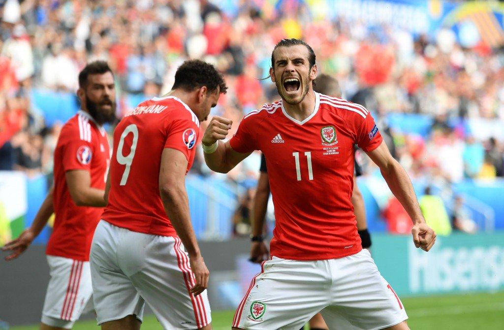 BORDEAUX, FRANCE - JUNE 11: Gareth Bale (R) of Wales celebrates his team