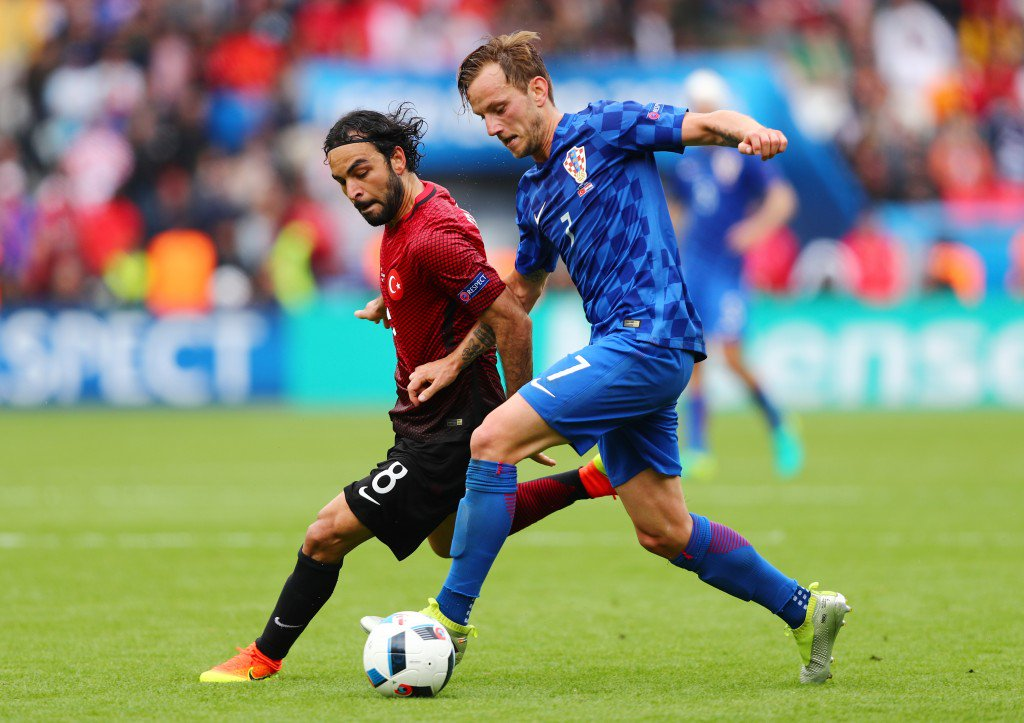 PARIS, FRANCE - JUNE 12: Ivan Rakitic of Croatia and Selcuk Inan of Turkey compete for the ball during the UEFA EURO 2016 Group D match between Turkey and Croatia at Parc des Princes on June 12, 2016 in Paris, France. (Photo by Clive Rose/Getty Images)