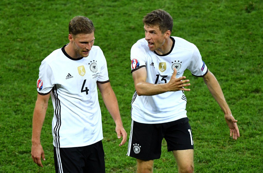 LILLE, FRANCE - JUNE 12: Benedikt Hoewedes (L) and Thomas Mueller (R) of Germany discuss while leaving the pitch after the first half during the UEFA EURO 2016 Group C match between Germany and Ukraine at Stade Pierre-Mauroy on June 12, 2016 in Lille, France. (Photo by Shaun Botterill/Getty Images)