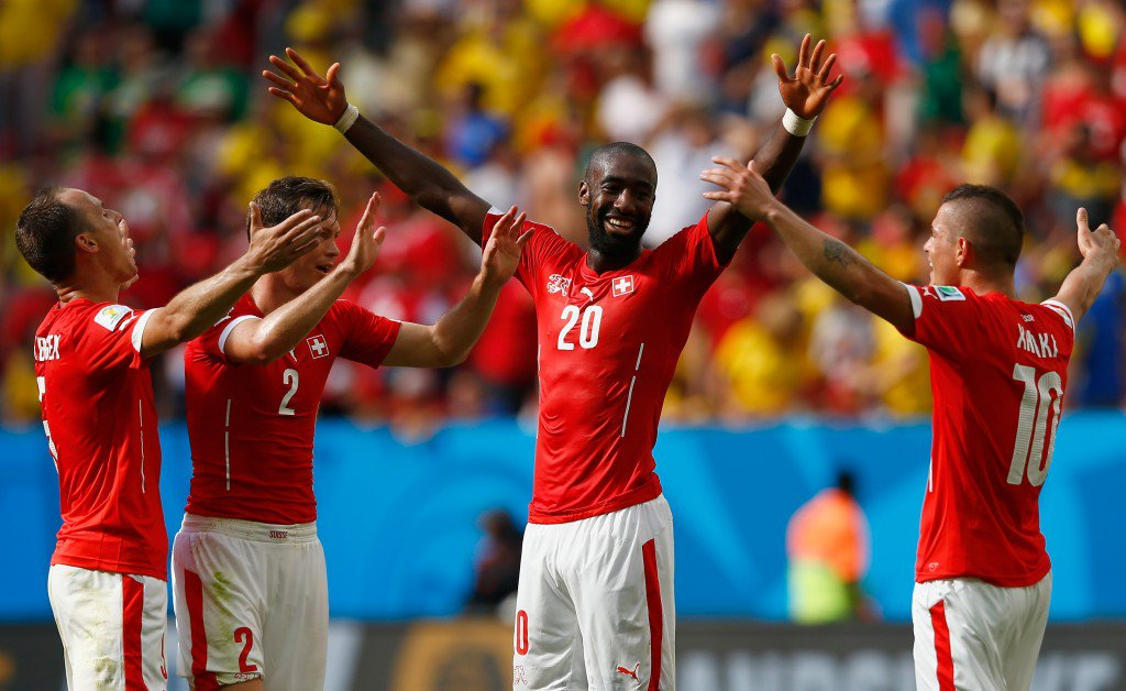 BRASILIA, BRAZIL - JUNE 15: Johan Djourou of Switzerland (2nd R) celebrates with Steve von Bergen (L), Stephan Lichtsteiner (2nd L) and Granit Xhaka after defeating Ecuador 2-1 in the 2014 FIFA World Cup Brazil Group E match between Switzerland and Ecuador at Estadio Nacional on June 15, 2014 in Brasilia, Brazil. (Photo by Matthew Lewis/Getty Images)