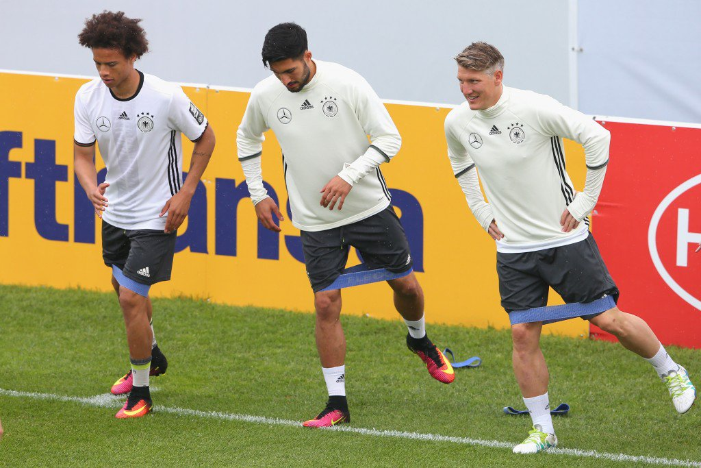 ASCONA, SWITZERLAND - JUNE 02: Bastian Schweinsteiger (R) of Germany warms up with his team mates Emre Can (C) and Leroy Sane during a training session at stadio communale on day 10 of the German national team trainings camp on June 2, 2016 in Ascona, Switzerland. (Photo by Alexander Hassenstein/Bongarts/Getty Images)