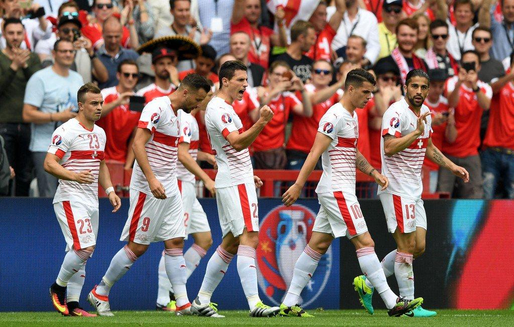 LENS, FRANCE - JUNE 11: Fabian Schaer (C) of Switzerland celebrates scoring his team