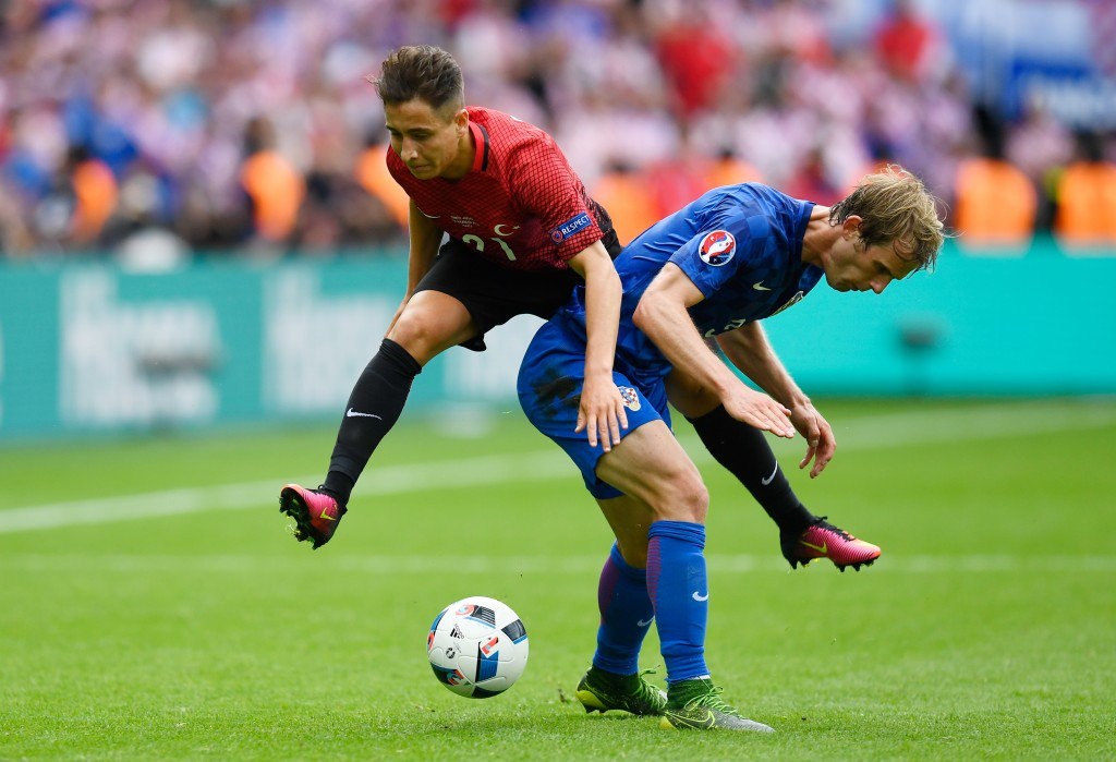 PARIS, FRANCE - JUNE 12: Emre Mor of Turkey is challenged by Ivan Strinic of Croatia during the UEFA EURO 2016 Group D match between Turkey and Croatia at Parc des Princes on June 12, 2016 in Paris, France. (Photo by Mike Hewitt/Getty Images)