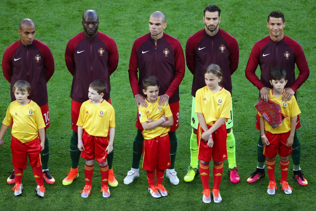 SAINT-ETIENNE, FRANCE - JUNE 14: Portugal players line up for the national anthem priro to the UEFA EURO 2016 Group F match between Portugal and Iceland at Stade Geoffroy-Guichard on June 14, 2016 in Saint-Etienne, France. (Photo by Julian Finney/Getty Images)