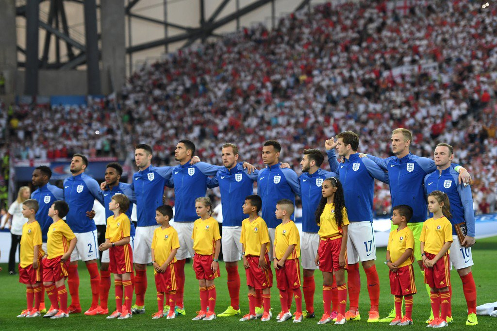 MARSEILLE, FRANCE - JUNE 11: England players line up for the national anthem prior to the UEFA EURO 2016 Group B match between England and Russia at Stade Velodrome on June 11, 2016 in Marseille, France. (Photo by Laurence Griffiths/Getty Images)