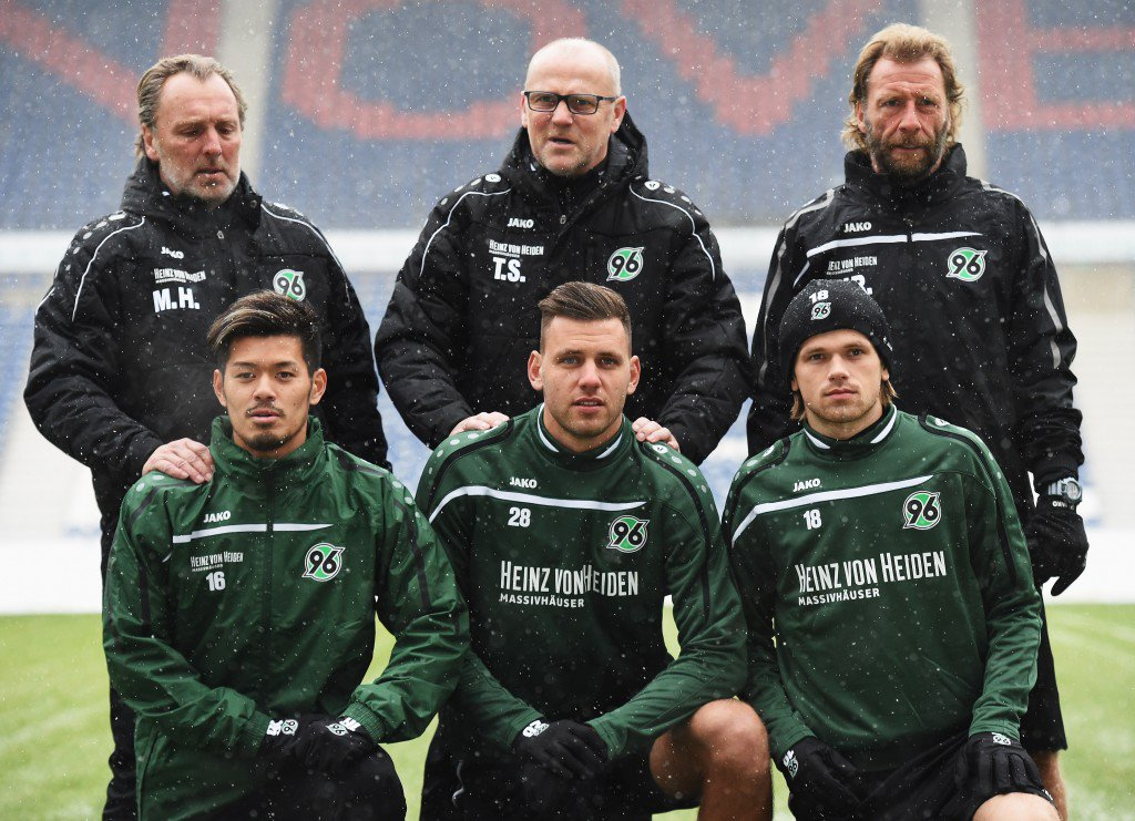 HANOVER, GERMANY - JANUARY 04: Thomas Schaaf, head coach of Hannover 96 poses for a photograph with new signings, (front row left to right) Hotaru Yamaguchi, Ádám Szalai and Iver Fossum during his first training session after the announcement of his appointment on January 4, 2016 in Hanover, Germany. (Photo by Stuart Franklin/Bongarts/Getty Images)