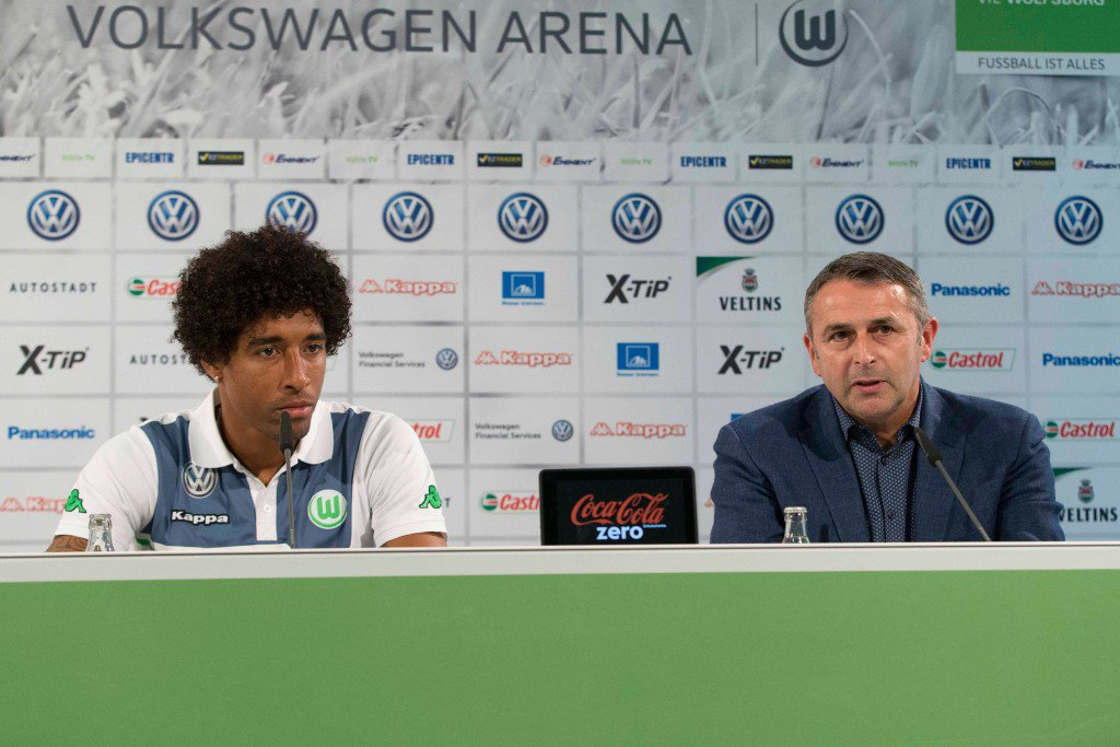WOLFSBURG, GERMANY - SEPTEMBER 01: Dante and Sporting Director Klaus Allofs of VfL Wolfsburg talk to the media during a press conference at Volkswagen Arena on September 1, 2015 in Wolfsburg, Germany. (Photo by Joachim Sielski/Bongarts/Getty Images)
