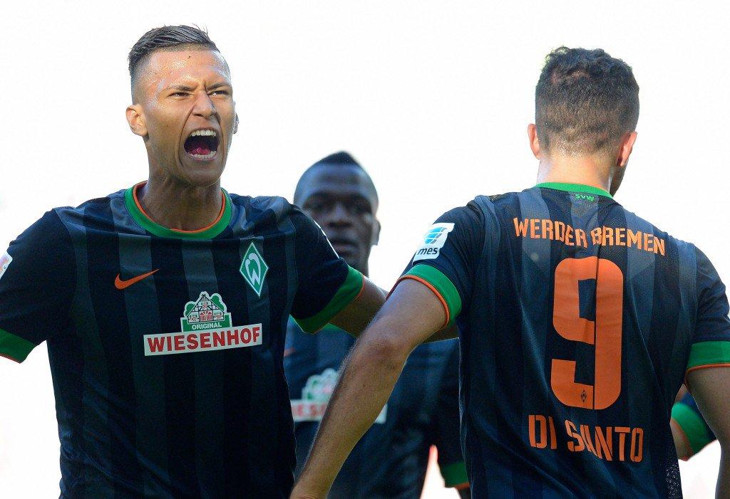 AUGSBURG, GERMANY - SEPTEMBER 20: Franco di Santo of Bremen (R) celebrates his team