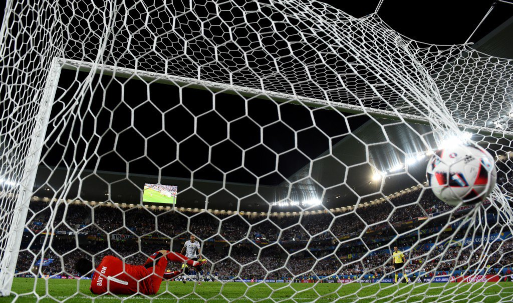 BORDEAUX, FRANCE - JULY 02: Jonas Hector of Germany scores at the penalty past Gianluigi Buffon of Italy shootout to win the game during the UEFA EURO 2016 quarter final match between Germany and Italy at Stade Matmut Atlantique on July 2, 2016 in Bordeaux, France. (Photo by Laurence Griffiths/Getty Images)