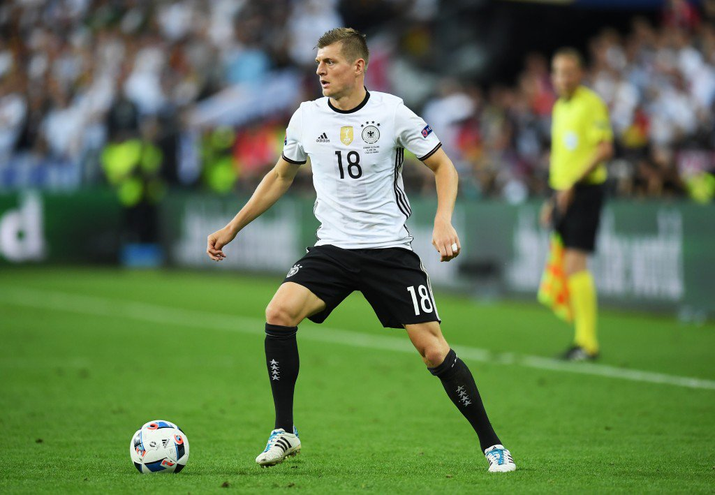 PARIS, FRANCE - JUNE 16: Toni Kroos of Germany in action during the UEFA EURO 2016 Group C match between Germany and Poland at Stade de France on June 16, 2016 in Paris, France. (Photo by Matthias Hangst/Getty Images)