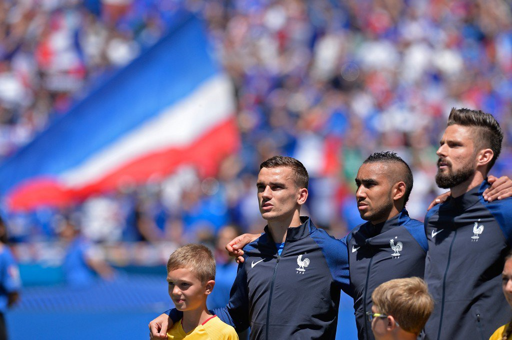 LYON, FRANCE - JUNE 26: Antoine Griezmann, Dimitri Payet, Olivier Giroud of France react during the national anthem before the UEFA Euro 2016 round of 16 match between France and the Republic of Ireland at Stade des Lumieres on June 26, 2016 in Lyon, France. (Photo by Aurelien Meunier/UEFA via Getty Images)