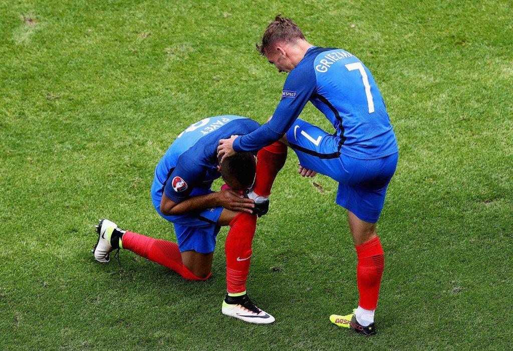 LYON, FRANCE - JUNE 26: Dimitri Payet (L) of France congratulates his team mate Antoine Griezmann (R) on scoring their team