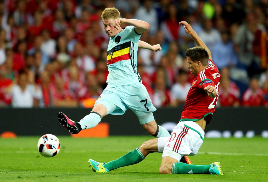 TOULOUSE, FRANCE - JUNE 26: Kevin De Bruyne of Belgium shoots at goal while Richard Guzmics of Hungary tries to block during the UEFA EURO 2016 round of 16 match between Hungary and Belgium at Stadium Municipal on June 26, 2016 in Toulouse, France. (Photo by Richard Heathcote/Getty Images)