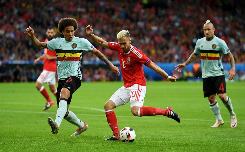 LILLE, FRANCE - JULY 01: Aaron Ramsey of Wales and Axel Witsel of Belgium compete for the ball during the UEFA EURO 2016 quarter final match between Wales and Belgium at Stade Pierre-Mauroy on July 1, 2016 in Lille, France. (Photo by Michael Regan/Getty Images)