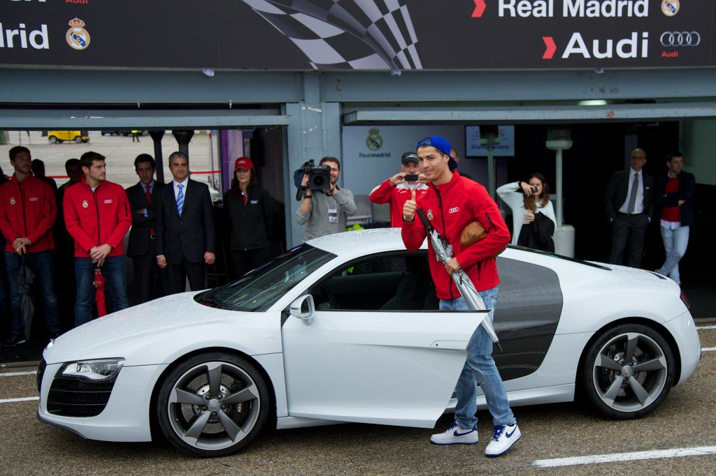 MADRID, SPAIN - NOVEMBER 08: Real Madrid player Cristiano Ronaldo receives a new Audi R8 Coupe at the Jarama racetrack on November 8, 2012 in Madrid, Spain. (Photo by Carlos Alvarez/Getty Images)
