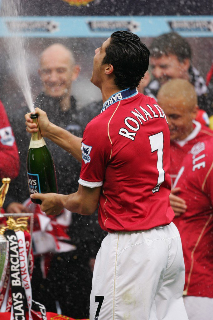 MANCHESTER, UNITED KINGDOM - MAY 13: Cristiano Ronaldo of Manchester United celebrates winning the Premiership title with champagne at the end of the Barclays Premiership match between Manchester United and West Ham United at Old Trafford on May 13, 2007 in Manchester, England. (Photo by Alex Livesey/Getty Images)