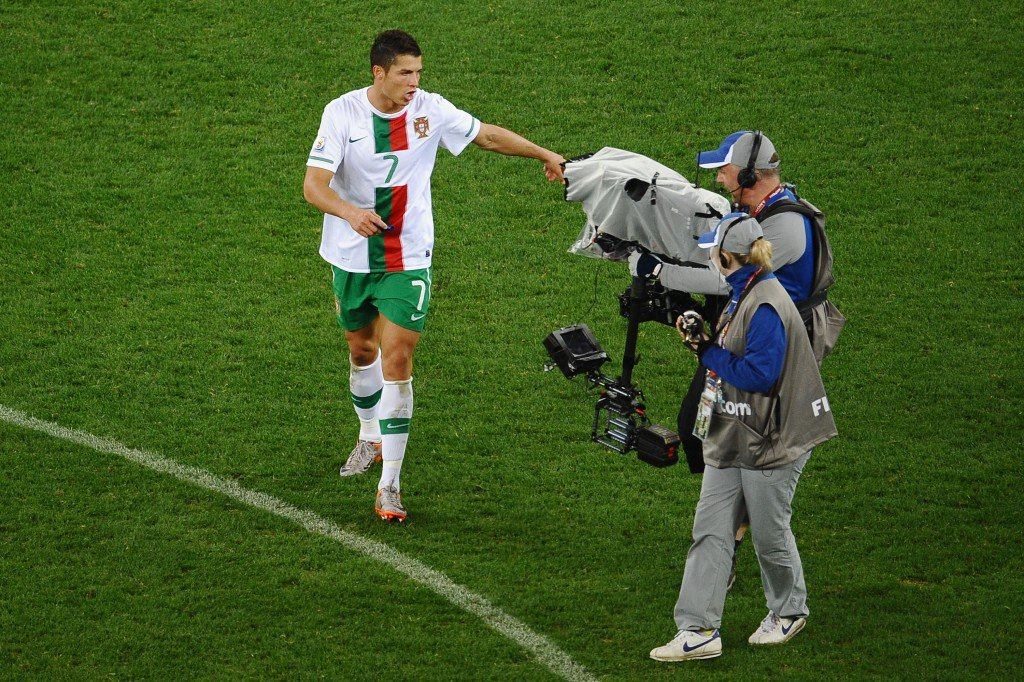CAPE TOWN, SOUTH AFRICA - JUNE 29: A dejected Cristiano Ronaldo of Portugal reacts to a TV camera after suffering defeat in the 2010 FIFA World Cup South Africa Round of Sixteen match between Spain and Portugal at Green Point Stadium on June 29, 2010 in Cape Town, South Africa. (Photo by Laurence Griffiths/Getty Images)