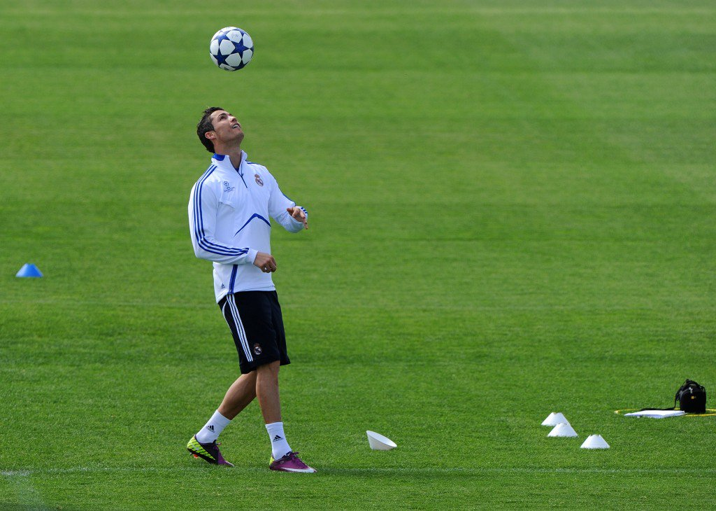 MADRID, SPAIN - APRIL 04: Cristiano Ronaldo of Real Madrid juggles the ball during a training session on the eve of their UEFA Champions League quarter final first leg match against Tottenham at the Valdebebas training ground on April 4, 2011 in Madrid, Spain. (Photo by Jasper Juinen/Getty Images)