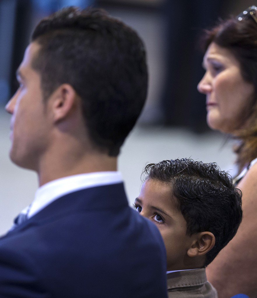 MADRID, SPAIN - OCTOBER 02: Cristiano Ronald JR looks to his father Cristiano Ronaldo next to his grandmother Maria Dolores dos Santos during Real Madrid CF president Florentino Perez speech at Honour box-seat of Santiago Bernabeu Stadium on October 2, 2015 in Madrid, Spain. Portuguese palyer Cristiano Ronaldo overtook on his last UEFA Champions League match against Malmo FF Raul