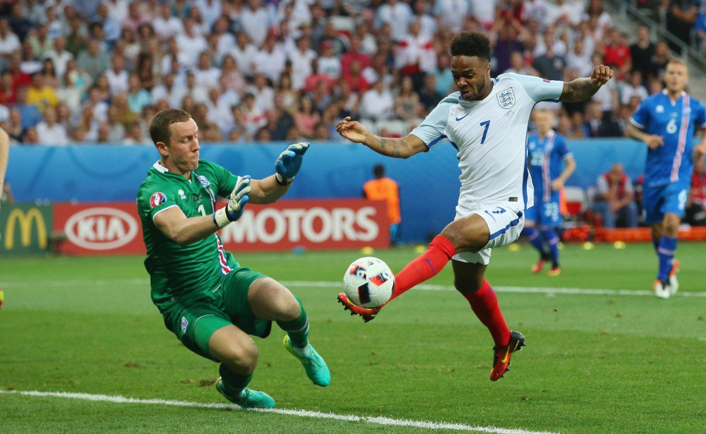 NICE, FRANCE - JUNE 27: Raheem Sterling of England is fouled in the penalty aera by Hannes Halldorsson of Iceland to win a penalty during the UEFA EURO 2016 round of 16 match between England and Iceland at Allianz Riviera Stadium on June 27, 2016 in Nice, France. (Photo by Alex Livesey/Getty Images)