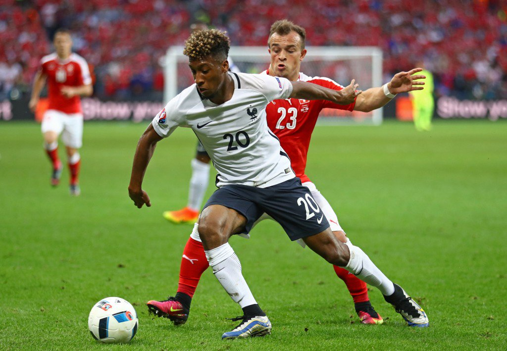 LILLE, FRANCE - JUNE 19: Kingsley Coman of France controls the ball under pressure of Xherdan Shaqiri of Switzerland during the UEFA EURO 2016 Group A match between Switzerland and France at Stade Pierre-Mauroy on June 19, 2016 in Lille, France. (Photo by Clive Mason/Getty Images)