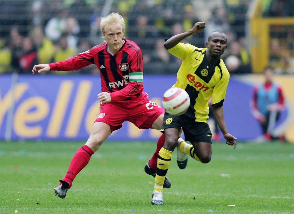 DORTMUND, GERMANY - APRIL 08: Carsten Ramelow of Leverkusen in action with Mathew Amoah of Dortmund during the Bundesliga match between Borussia Dortmund and Bayer 04 Leverkusen at Signal Iduna Park on April 8, 2006 in Dortmund, Germany. (Photo by Lars Baron/Bongarts/Getty Images)