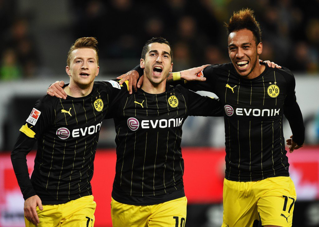 WOLFSBURG, GERMANY - DECEMBER 05: Marco Reus of Dortmund celebrates scoring his goal with Henrikh Mkhitaryan and Pierre-Emerick Aubameyang during the Bundesliga match between VfL Wolfsburg and Borussia Dortmund at Volkswagen Arena on December 5, 2015 in Wolfsburg, Germany. (Photo by Stuart Franklin/Bongarts/Getty Images)