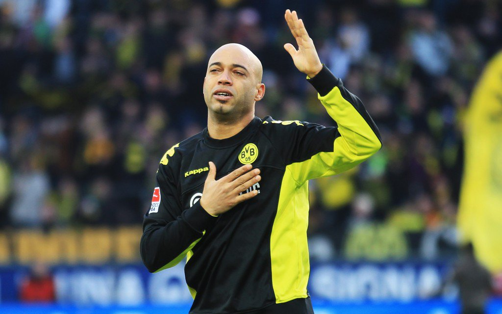DORTMUND, GERMANY - MARCH 19: Dede of Dortmund gestures to the fans prior to the Bundesliga match between Borussia Dortmund and FSV Mainz 05 at Signal Iduna Park on March 19, 2011 in Dortmund, Germany. (Photo by Joern Pollex/Bongarts/Getty Images)