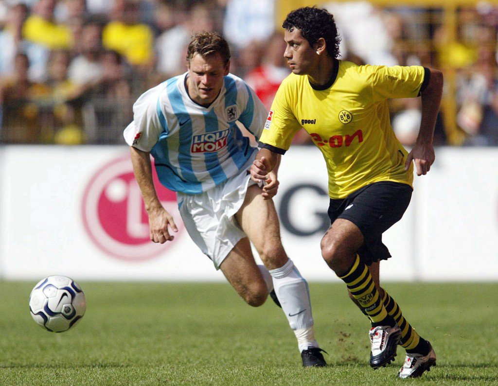 DORTMUND, GERMANY - AUGUST 16: 1. Bundesliga 03/04, Dortmund; Borussia Dortmund - TSV 1860 Muenchen 3:1; Andreas GOERLITZ/1860, Juan Ramon FERNANDEZ/Dortmund (Photo by Friedemann Vogel/Bongarts/Getty Images)