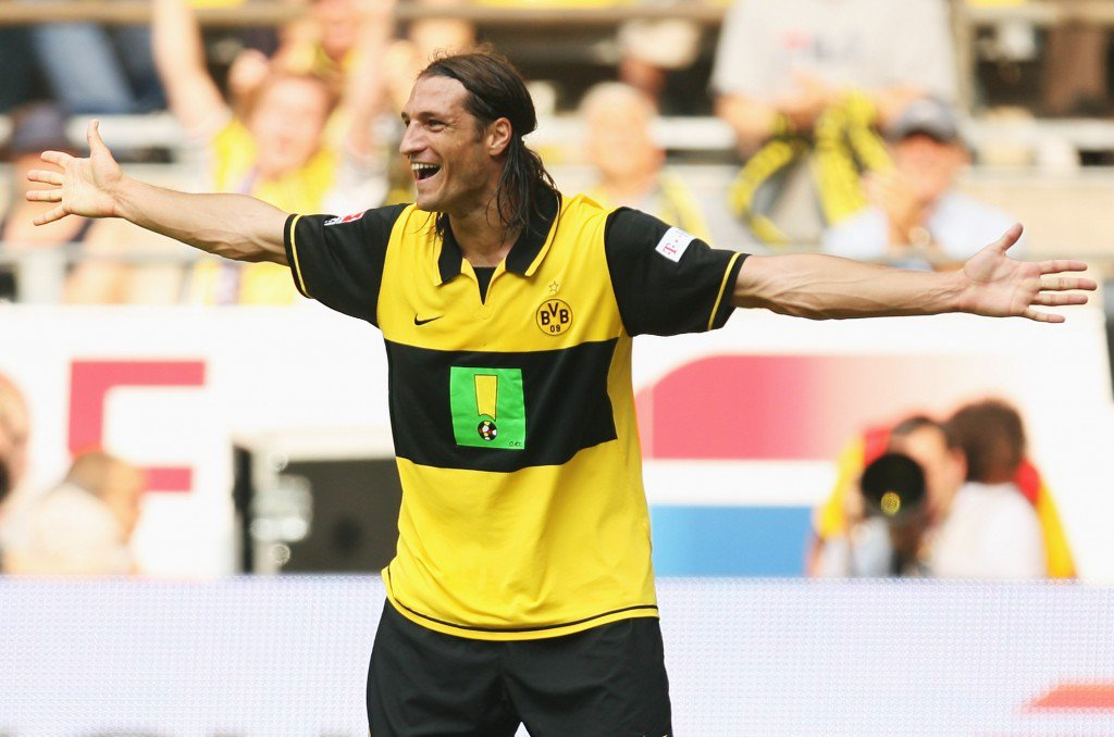 DORTMUND, GERMANY - AUGUST 25: Diego Klimowicz of Dortmund celebrates scoring the second goal during the Bundesliga match between Borussia Dortmund and FC Energie Cottbus at the Signal Iduna Park on August 25, 2007 in Dortmund, Germany. (Photo by Lars Baron/Bongarts/Getty Images)