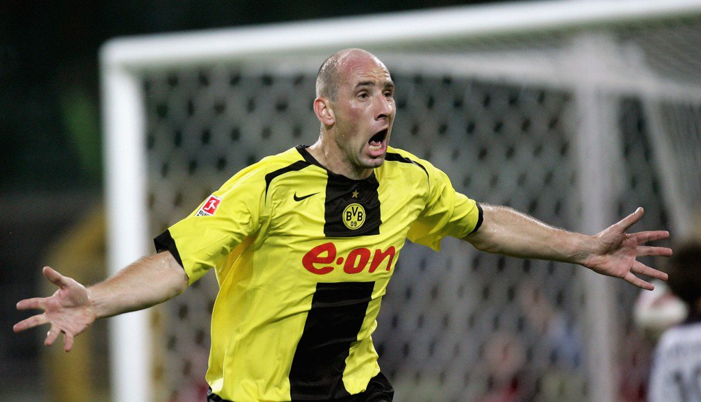 DORTMUND, GERMANY - SEPTEMBER 20: Jan Koller of Dortmund celebrates scoring the first goal during the Bundesliga match between Borussia Dortmund and Arminia Bielefeld at the Wesfalen Stadium on September 20, 2005 in Dortmund, Germany. (Photo by Alexander Hassenstein/Bongarts/Getty Images)