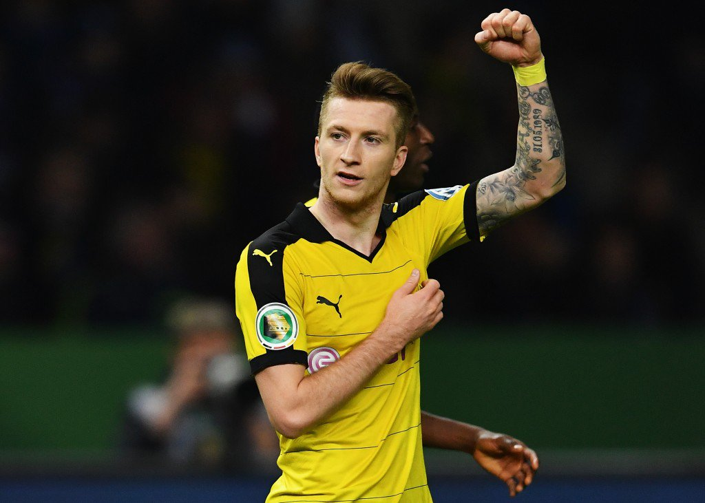 BERLIN, GERMANY - APRIL 20: Marco Reus of Dortmund celebrates after scoring his teams second goal during the DFB Cup semi final match between Hertha BSC Berlin and Borussia Dortmund at Olympia Stadium on April 20, 2016 in Berlin, Germany. (Photo by Stuart Franklin/Bongarts/Getty Images)