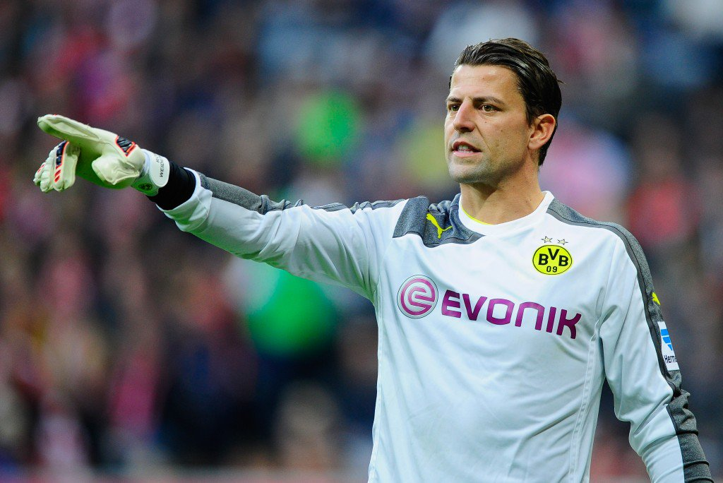 MUNICH, GERMANY - APRIL 12: Roman Weidenfeller of Dortmund reacts during the Bundesliga match between FC Bayern Muenchen and Borussia Dortmund at Allianz Arena on April 12, 2014 in Munich, Germany. (Photo by Lennart Preiss/Bongarts/Getty Images)