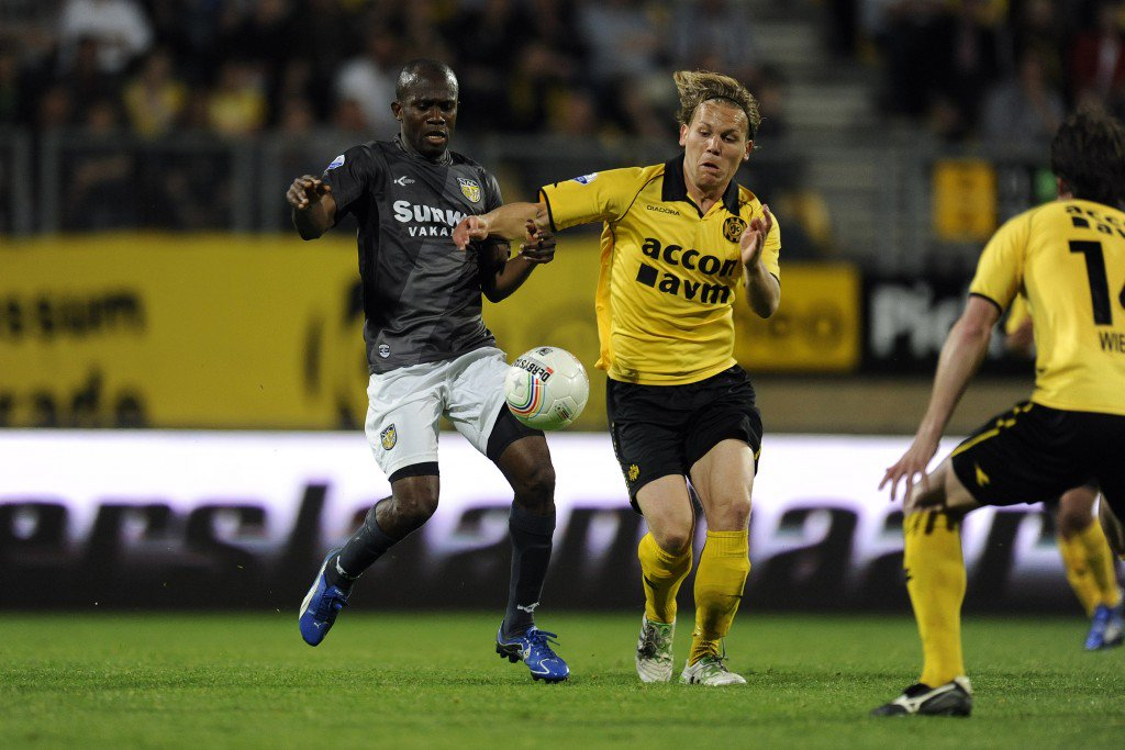 KERKRADE, NETHERLANDS - APRIL 23: Matthew Amoah (L) of NAC Breda and Ruud Vormer (R) of Roda JC Kerkrade during the Eredivisie match between Roda JC Kerkrade and NAC Breda at Parkstad Limburg Stadium on April 23, 2011 in Kerkrade, Netherlands. (Photo by EuroFootball/Getty Images)