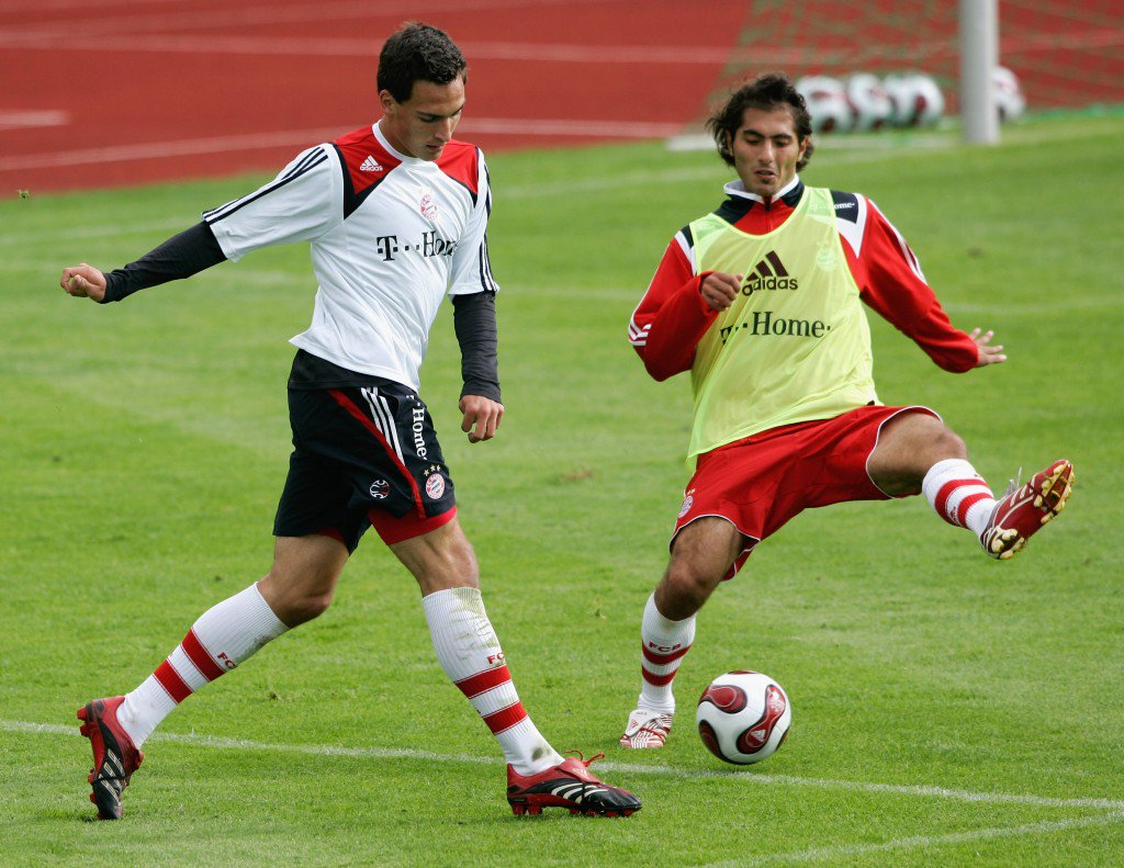 DONAUESCHINGEN, GERMANY - JULY 10: Mats Hummels (L) shoots the ball and Hamit Altintop (R) tries to block the ball during the training session at the training camp of Bayern Munich on July 10, 2007 in Donaueschingen, Germany. (Photo by Christof Koepsel/Bongarts/Getty Images)