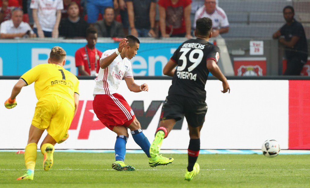 LEVERKUSEN, GERMANY - SEPTEMBER 10: Shou Bobby Wood of Hamburg scores his teams first goal against goalkeeper Bernd Leno of Leverkusen during the Bundesliga match between Bayer 04 Leverkusen and Hamburger SV at BayArena on September 10, 2016 in Leverkusen, Germany. (Photo by Lars Baron/Bongarts/Getty Images)