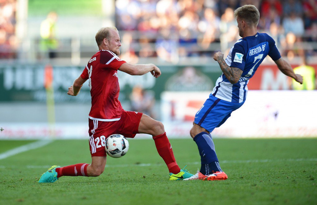INGOLSTADT, GERMANY - SEPTEMBER 10: Tobias Levels (L) of Ingolstadt and Alexander Esswein of Berlin tussle for the ball during the Bundesliga match between FC Ingolstadt 04 and Hertha BSC at Audi Sportpark on September 10, 2016 in Ingolstadt, Germany. (Photo by Micha Will/Bongarts/Getty Images)
