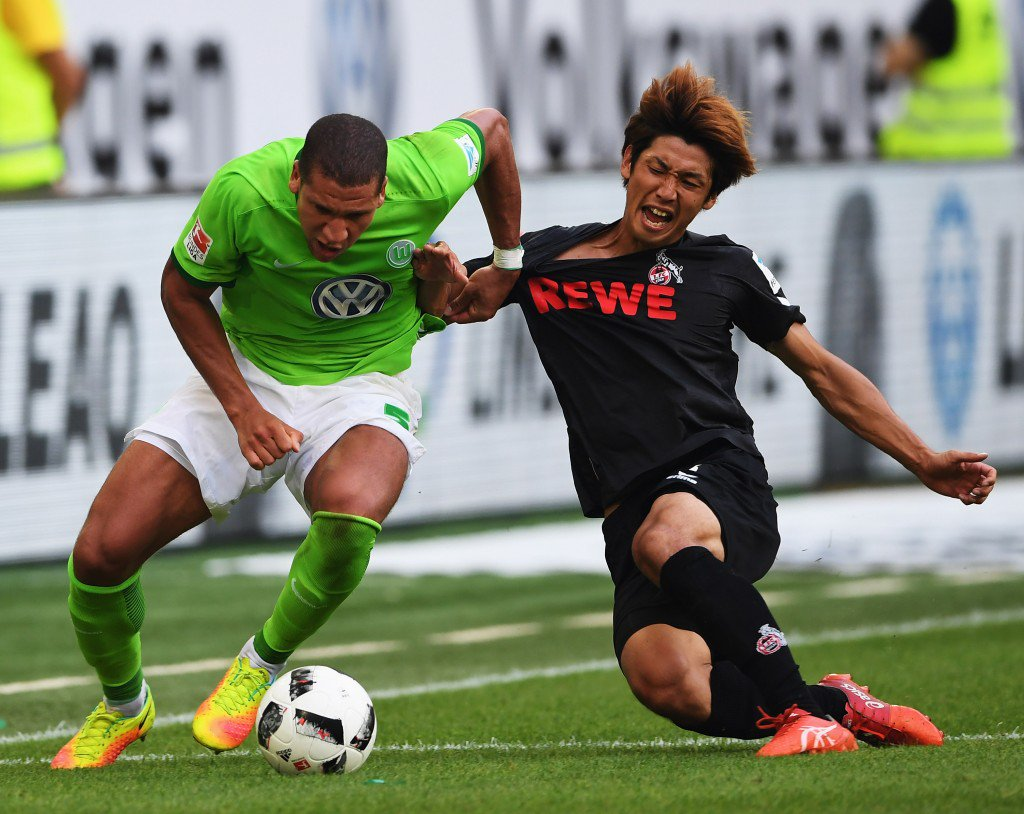WOLFSBURG, GERMANY - SEPTEMBER 10: Jeffery Bruma of Wolfsburg is challenged by Yuya Osako of Cologne during the Bundesliga match between VfL Wolfsburg and 1. FC Koeln at Volkswagen Arena on September 10, 2016 in Wolfsburg, Germany. (Photo by Stuart Franklin/Bongarts/Getty Images)
