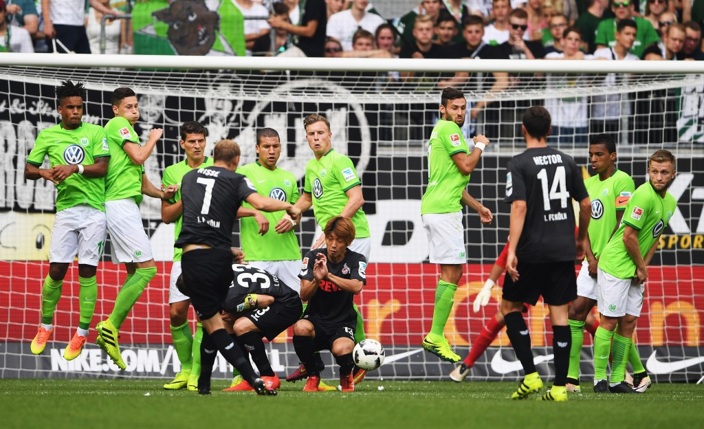 WOLFSBURG, GERMANY - SEPTEMBER 10: Marcel Risse of Cologne takes a free kick against a wall of Wolfsburg players during the Bundesliga match between VfL Wolfsburg and 1. FC Koeln at Volkswagen Arena on September 10, 2016 in Wolfsburg, Germany. (Photo by Stuart Franklin/Bongarts/Getty Images)