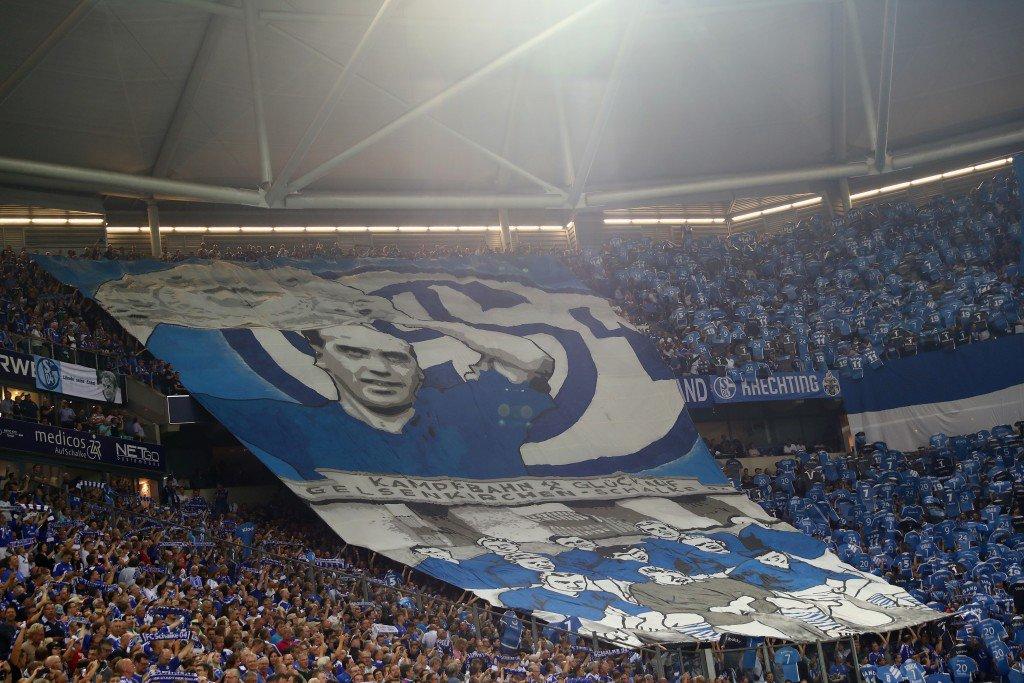 GELSENKIRCHEN, GERMANY - SEPTEMBER 09: Fans of Schalke prior to the Bundesliga match between FC Schalke 04 and Bayern Muenchen at Veltins-Arena on September 9, 2016 in Gelsenkirchen, Germany. (Photo by Alex Grimm/Bongarts/Getty Images)