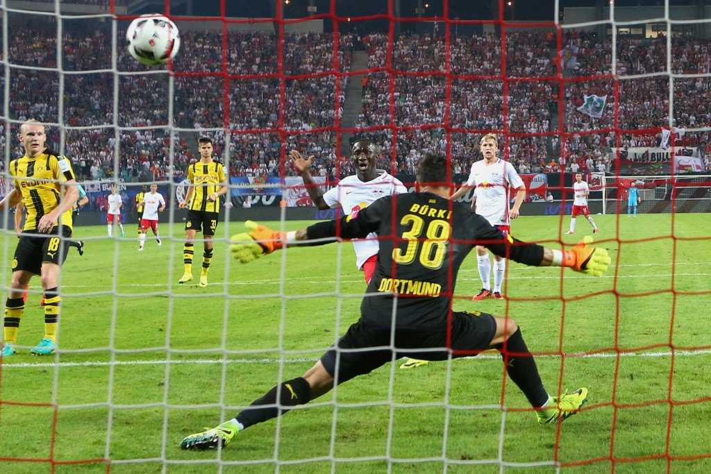 LEIPZIG, GERMANY - SEPTEMBER 10: Naby Deco Keita of Leipzig scores the first goal against Roman Buerki, keeper of Dortmund during the Bundesliga match between RB Leipzig and Borussia Dortmund at Red Bull Arena on September 10, 2016 in Leipzig, Germany. (Photo by Alexander Hassenstein/Bongarts/Getty Images)