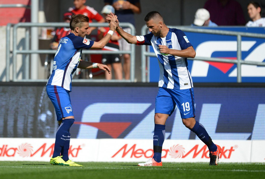 INGOLSTADT, GERMANY - SEPTEMBER 10: Vedad Ibisevic (L) of Berlin celebrates with Peter Pekark of Berlin after scoring the opening/first goal during the Bundesliga match between FC Ingolstadt 04 and Hertha BSC at Audi Sportpark on September 10, 2016 in Ingolstadt, Germany. (Photo by Micha Will/Bongarts/Getty Images)