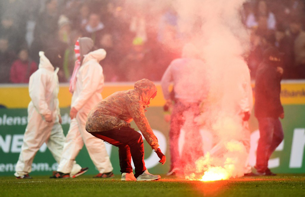 MOENCHENGLADBACH, GERMANY - FEBRUARY 14: Fans of Koeln are running on the pitch after loosing the Bundesliga match between Borussia Moenchengladbach and 1. FC Koeln at Borussia Park Stadium on February 14, 2015 in Moenchengladbach, Germany. (Photo by Lars Baron/Bongarts/Getty Images)
